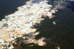 Plane view of Amazon landscape scarred by open pit gold mining [peru_aerial_1469]