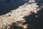 Plane view of Amazon landscape scarred by open pit gold mining