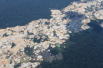 Aircraft view of Amazon landscape scarred by open pit gold mining