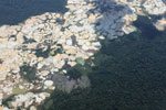 Aircraft view of Amazon rainforest landscape scarred by open pit gold mining