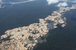 Airplane view of Amazon landscape scarred by open pit gold mining [peru_aerial_1499]