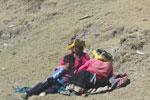 Quechua resting by a road