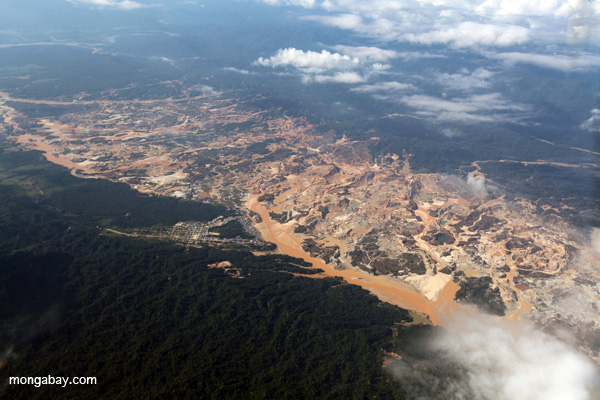 Río Huaypetue gold mine in Peru as seen from the air. Changing human behavior is key to tackling environmental problems. Photo by: Rhett A. Butler.