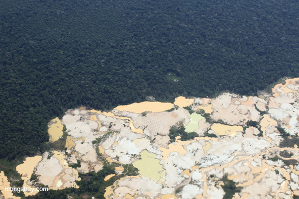 Airplane view of Peruvian Amazon landscape scarred by open pit gold mining. Photo by: Rhett A. Butler.