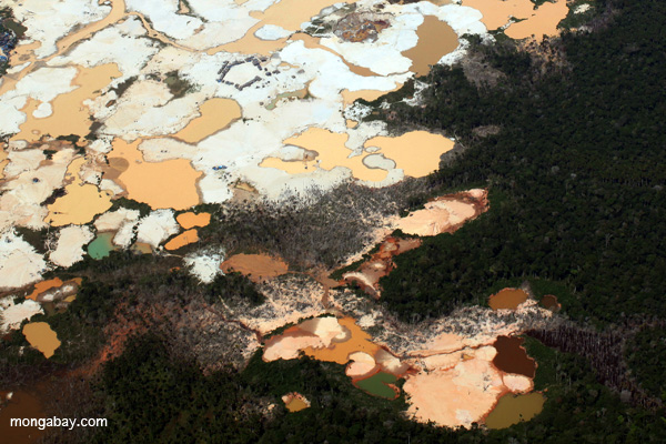 Plane view of Amazon landscape scarred by open pit gold mining.