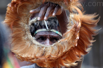 Papuan man holding a feather headdress