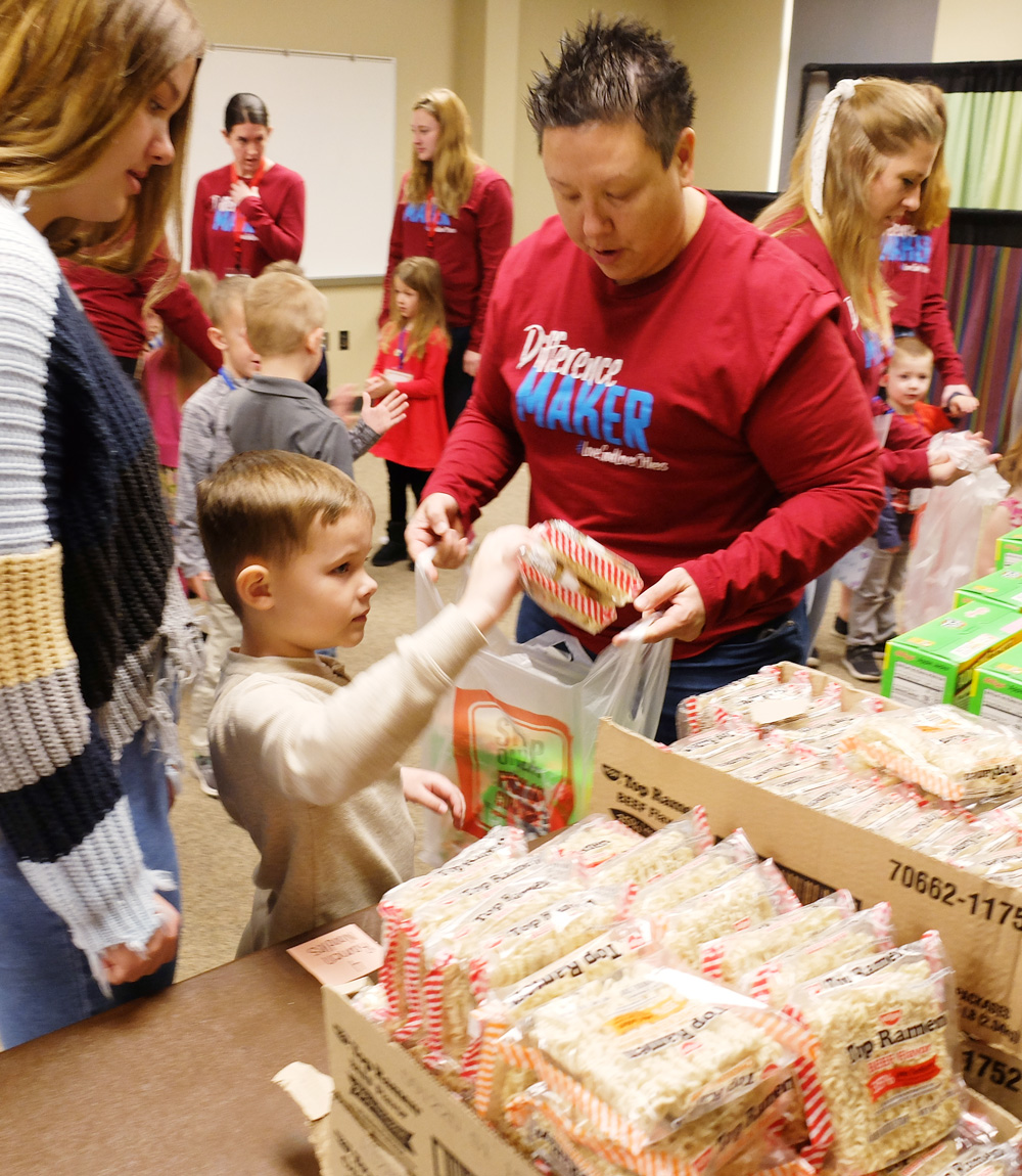 photo: students and teachers packing food supplies