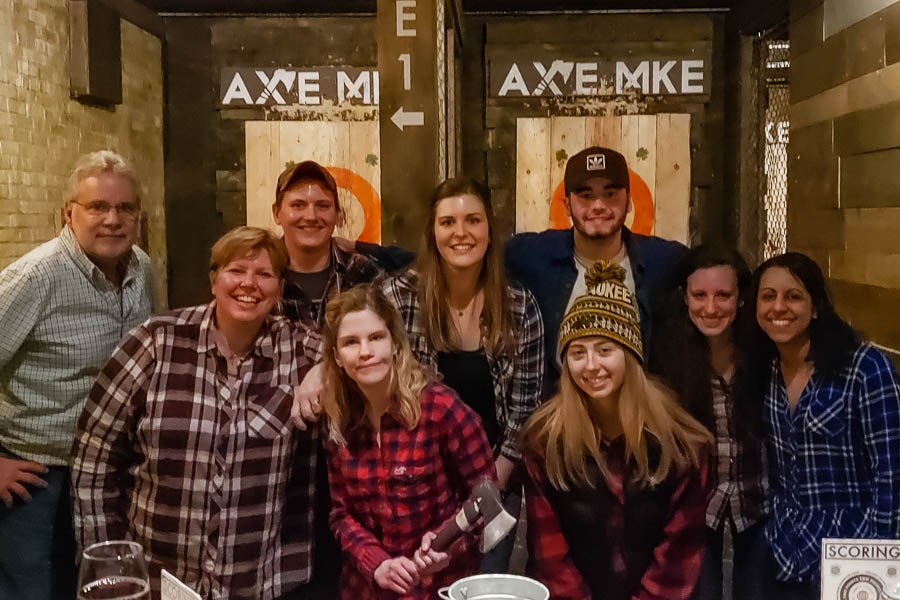 Young professional group outing an an ax throwing venue