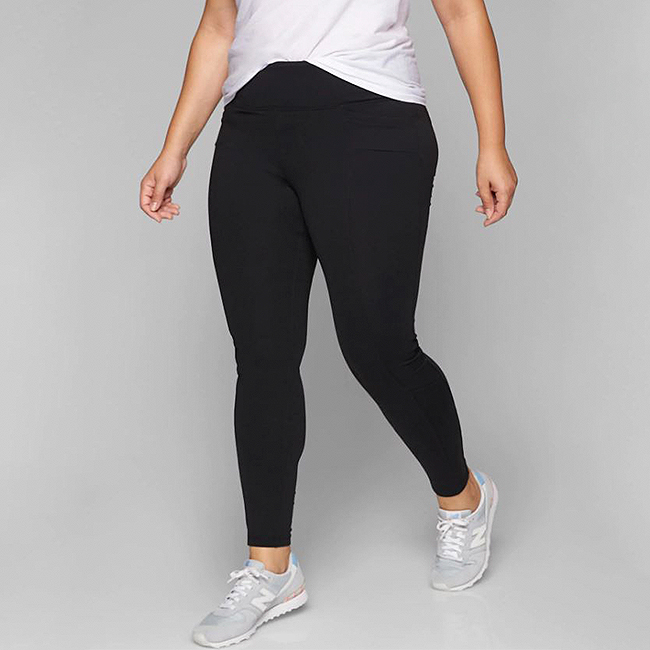 6f5678ad87e651 Model wearing plus size black leggings and a white tee and sneakers