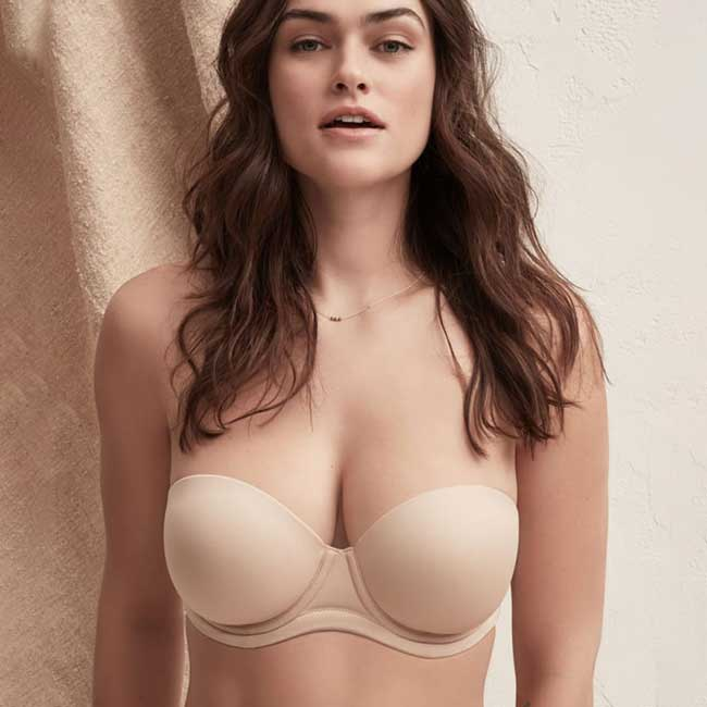 Model wearing light skin tone strapless bra for big bust