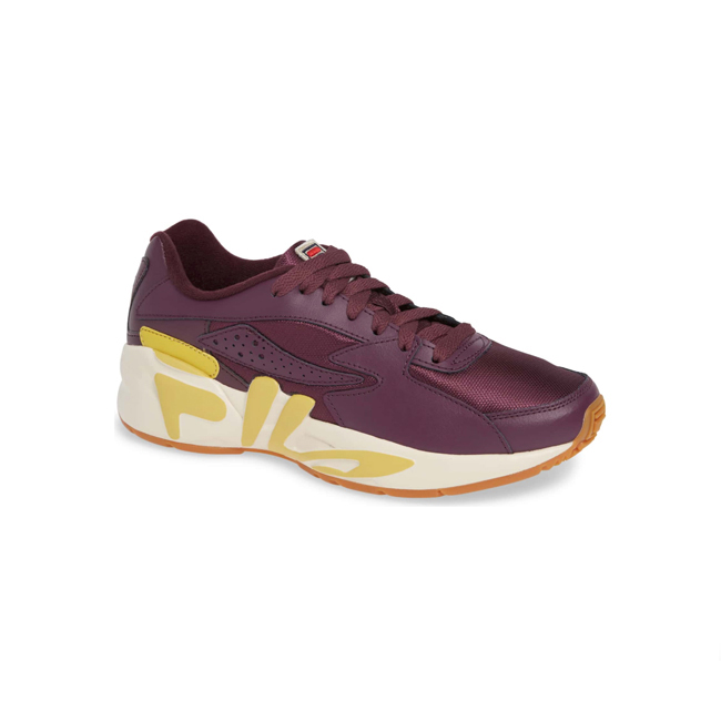 Profile photo of chunky burgundy leather and fabric sneaker with platform ivory sole and large yellow Fila logo across side
