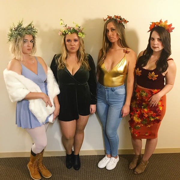 four women dressed as the four seasons for a group halloween costume