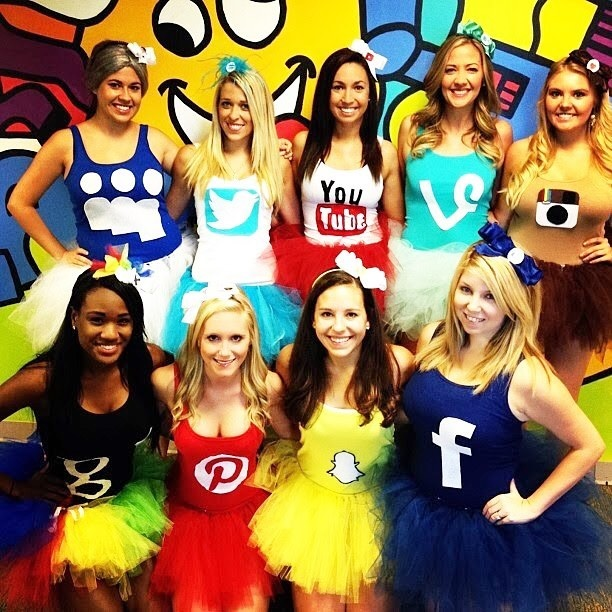 women dressing up as social media sites in a group halloween costume
