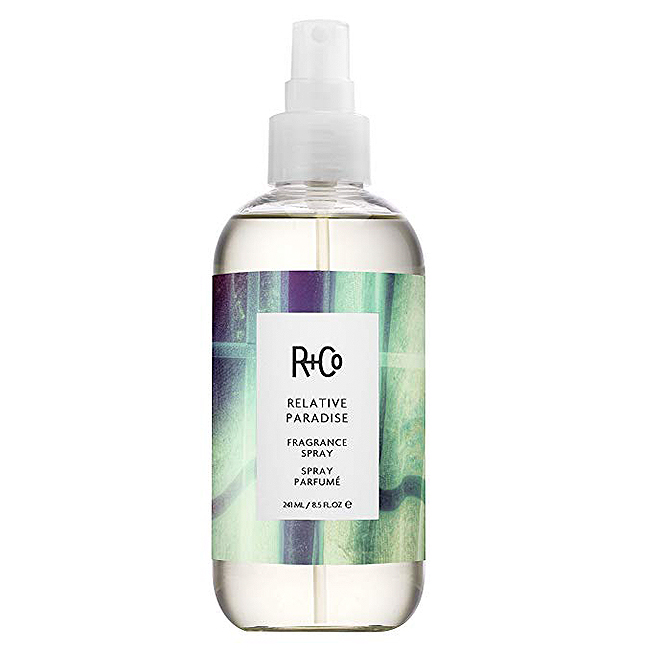 R+Co fragrance spray in a clear bottle with a white spritzer