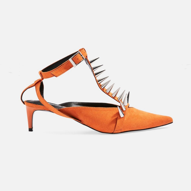 Profile photo of bright orange suede pointy-toe kitten heels with silver spikes on the T-strap