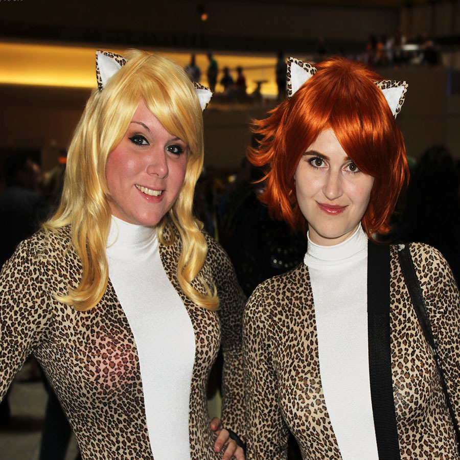 Women wearing Josie and The Pussycats comic book costumes