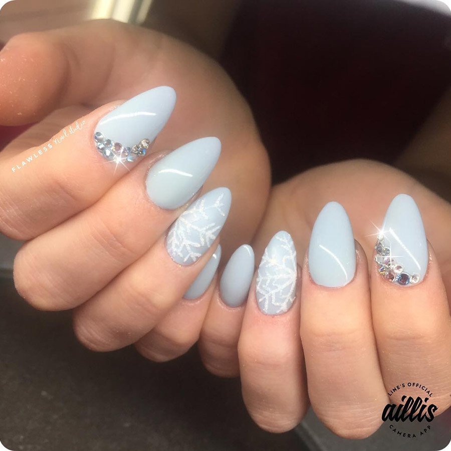 These 25 Snowflake Nail Designs Will Have You Feeling Chill