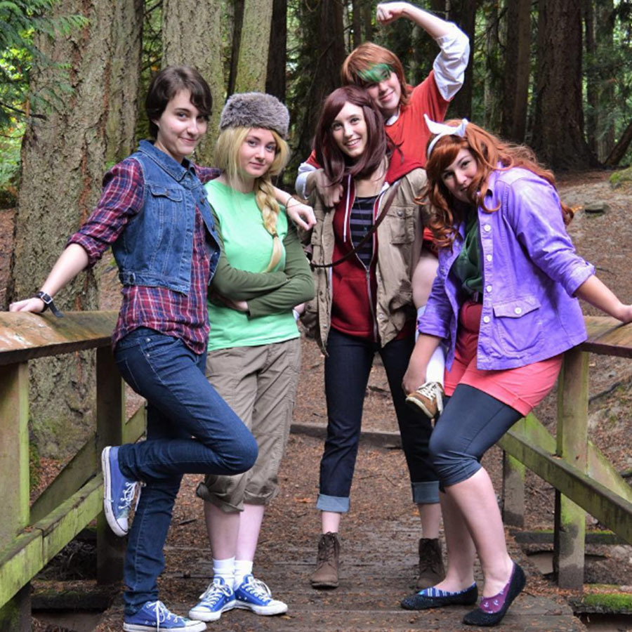 A group of women dressed in comic book inspired costumes from the