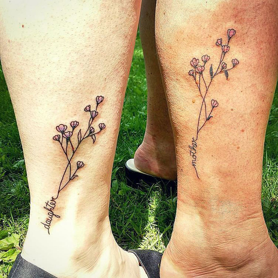 267ab6c91 There's something so elegant about these matching tattoos on Ashely C and  her mother. Perhaps it's because baby's breath stands for everlasting love,  ...