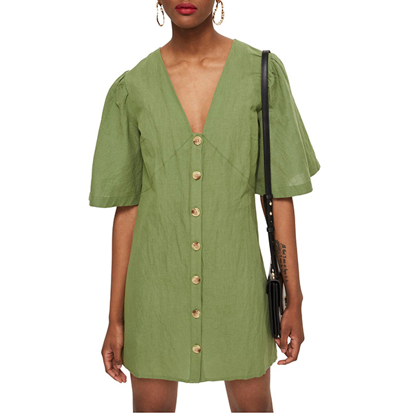 woman wearing a green button front dress with short sleeves