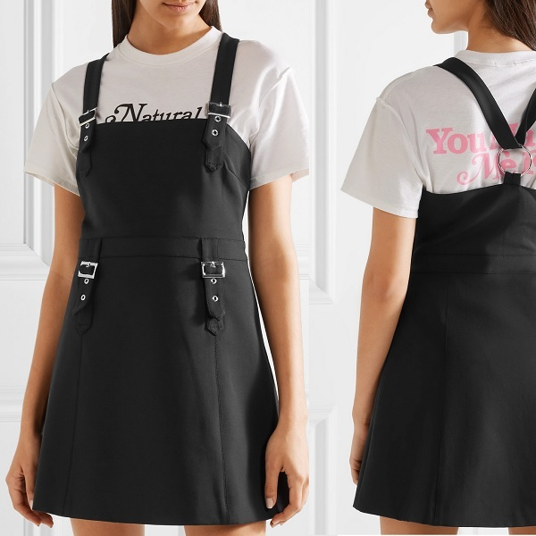 black overall dress with hardware details