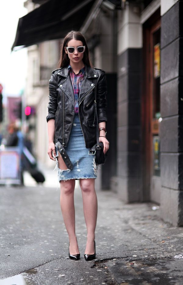 woman wearing a ripped denim skirt outfit