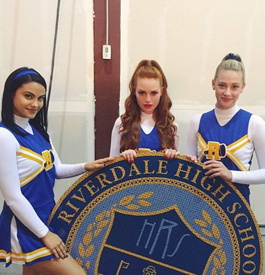 Veronica Lodge, Cheryl Blossom, and Betty Cooper characters in costume on the tv show Riverdale