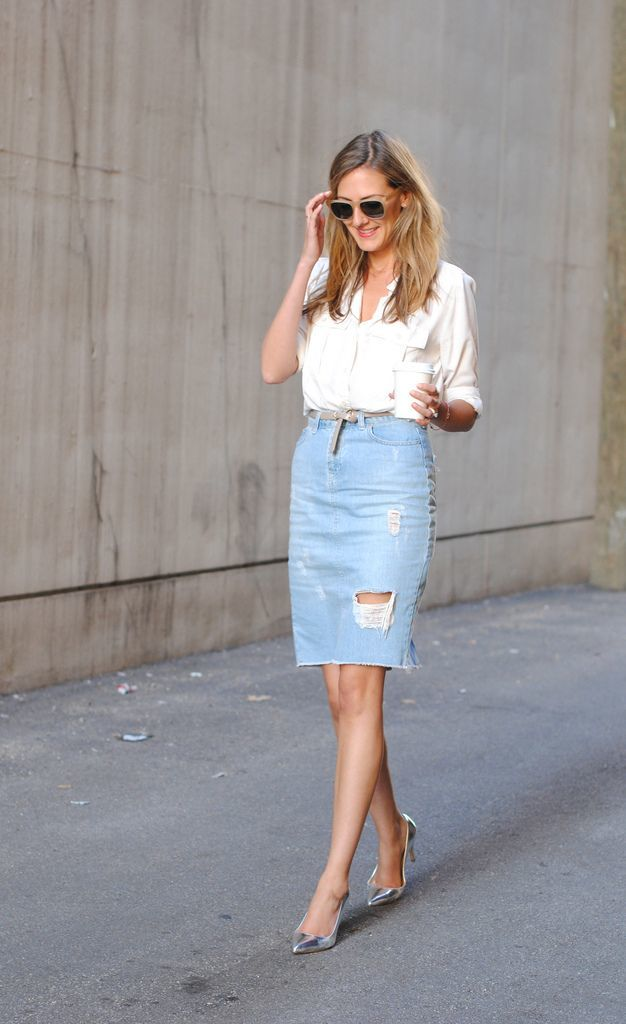 woman wearing a distressed denim skirt