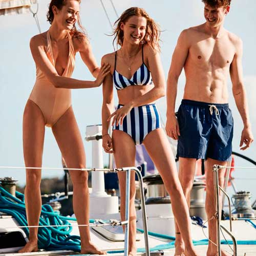 Women wearing Solid & Striped swimwear on a boat