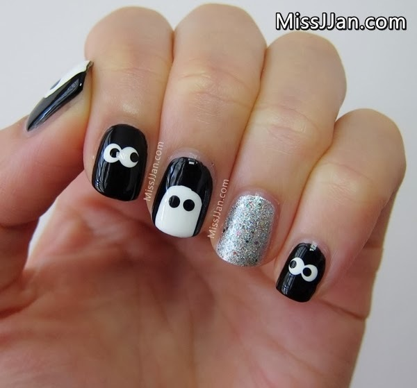 halloween nails with spooky eyes