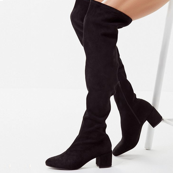 black over the knee boots on a woman
