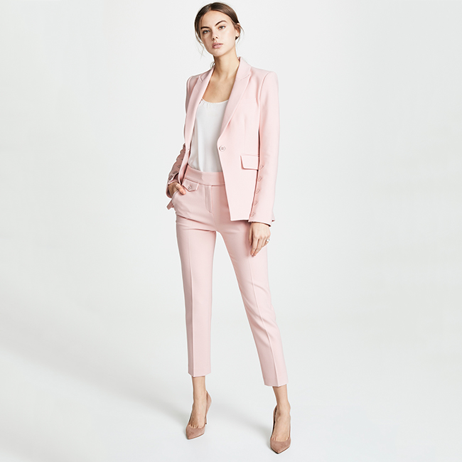 Light pink suit with a white tank underneath and heels