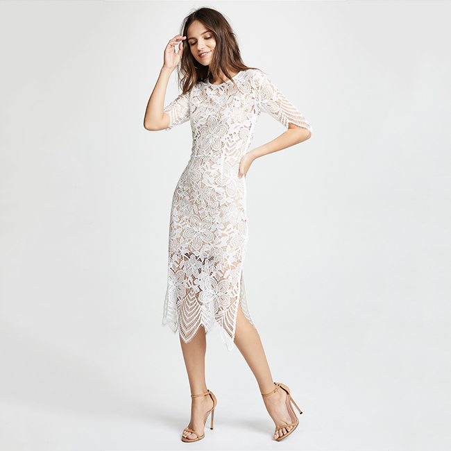 All over floral lace dress, with a lace, zigzag hemline and back cutout