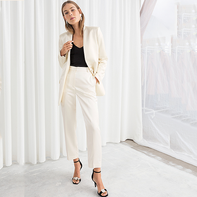 White tailored blazer and high-waist pant suit with a black tank top