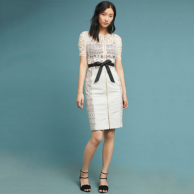 White lace sheath dress with a black bow tied grosgrain ribbon waist