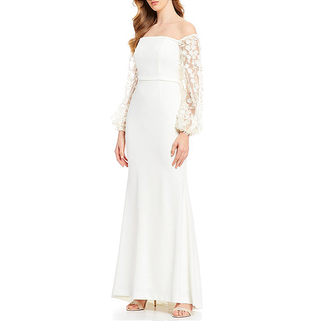 Ivory full-length dress with off the shoulder balloon sleeves decorated in 3D floral adornments