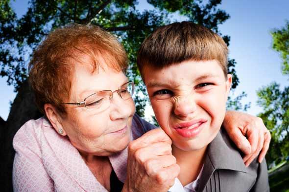 Older aunt pinching cheeks