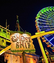 Ghost Ship And Giant Wheel At Night