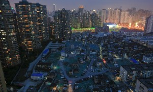 A night view of the old houses surrounded by new apartment buildings at Guangfuli neighbourhood in Shanghai, China, April 10,