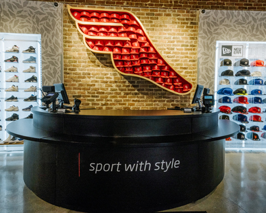 Adamick Architecture collaborated with Athlete's Foot to create a customized, New Orleans-themed retail store design.