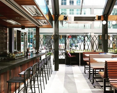 The custom concrete restaurant flooring was designed by Concrete Collaborative in this gorgeous bar and restaurant design project.