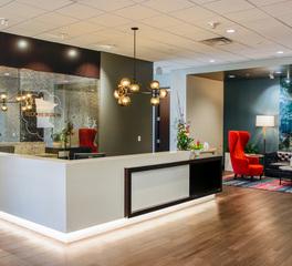 GlassArt Design BCVB  Reception Desk Featuring Antique Mirrored Glass Panels