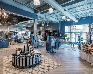 A spacious salesfloor at Hulla B'Lu retail store desgin in Lubbock, Texas, by Parkhill Smith & Cooper.