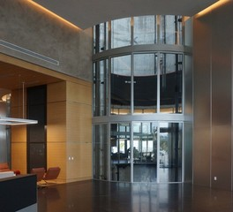 Safti first Porsche interior curtain wall system glazing