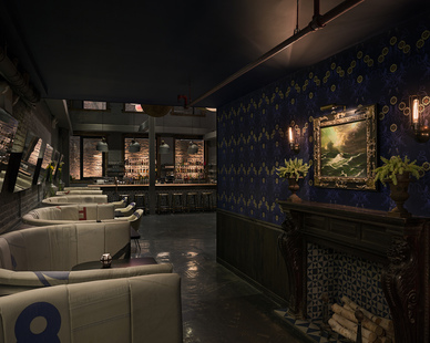 STUDIO robert jamieson designed this modern bar with custom bar seating upholstered with reclaimed patchwork sailcloth.