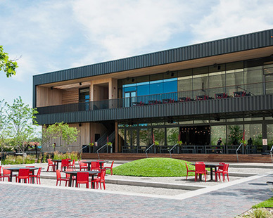Surly Brewing sits on top of reclaimed industrial land and chose to use benches and tables from Loll Designs