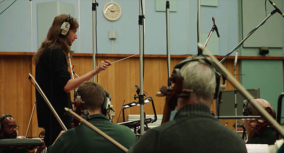 Ludwig Göransson conducts orchestra at Abby Road Studios
