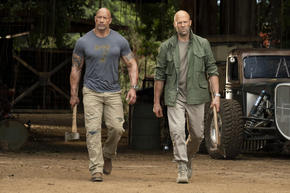"This image released by Universal Pictures shows Dwayne Johnson, left, and Jason Statham in a scene from ""Fast & Furious Presents: Hobbs & Shaw."" (Frank Masi/Universal Pictures via AP)"
