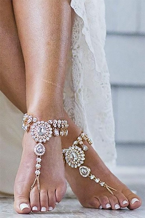 Sand in your shoes on the beach is a real downer. So why not go with barefoot sandals? These beach wedding shoes have all the bling without the hassel. Buy or find out more. #FeetJewelry #BeachWedding #SummerWedding #MyOnlineWeddingHelp #BarefootSandals