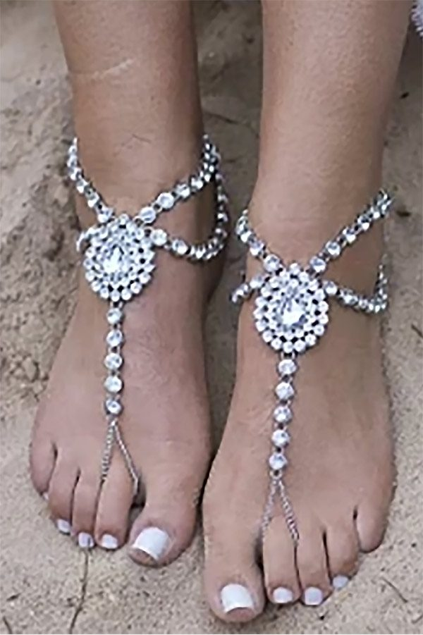 So fancy. Barefoot sandals with crystal rhinestones. Cute as summer wedding shoes or a party at the beach. #BeachWedding #BarefootSandals #MyOnlineWeddingHelp #SummerWedding
